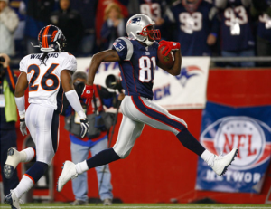 (Randy Moss (81) trots into the end-zone for his second touchdown of the night, early in the fourth quarter)