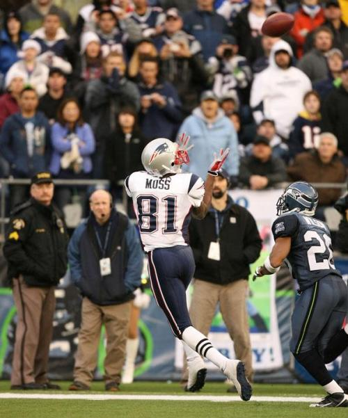 (Patriots' Wide Receiver, Randy Moss (81), beats Seahawks' safety, Josh Wilson (26), to make a crucial third down catch in the third quarter)