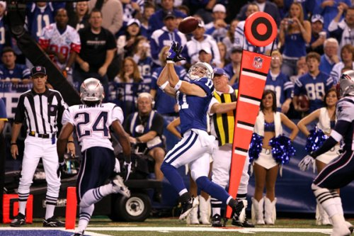 (Colts wide receiver, Anthony Gonzalez (11), beat Patriots rookie cornerback, Jonathan Wilhite (24), for his first of two touchdowns of the night)