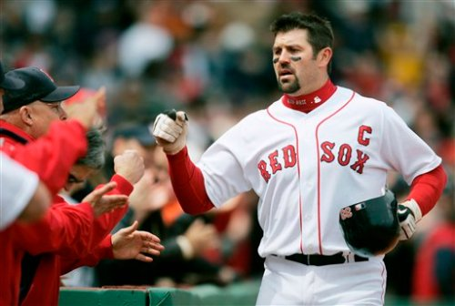 Captain Jason Varitek returns to the dugout after belting a solo home run.
